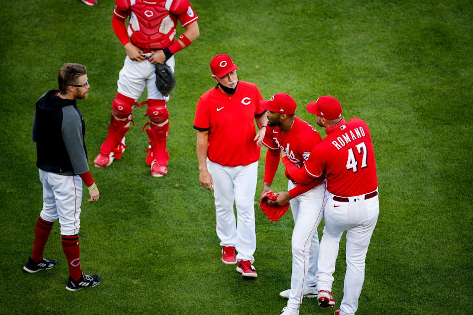 Reds pitcher Sal Romano (47) holds back Amir Garrett as the benches clear against the Chicago Cubs.