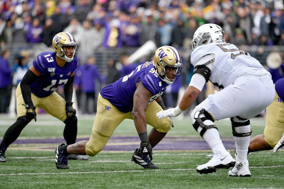 Levi Onwuzurike (center) of the Washington Huskies gets off the ball during the game against the Oregon Ducks at Husky Stadium on Oct. 19, 2019 in Seattle.