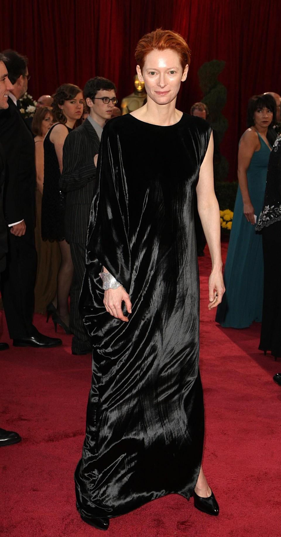 <p>Swinton appears to have fallen over in a fabric shop and attended the 2008 Oscars with whatever landed on her. <em>[Photo: PA]</em> </p>