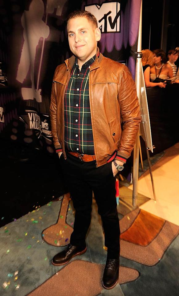 """A slimmed-down Jonah Hill, one of the night's presenters, struck a kinda awkward pose while donning a leather jacket and plaid shirt. Kevin Mazur/<a href=""""http://www.wireimage.com"""" target=""""new"""">WireImage.com</a> - August 28, 2011"""