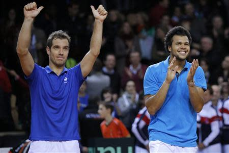 French players Tsonga and Gasquet celebrate after defeating Australian players Hewitt and Guccione during their Davis Cup world group first round tennis doubles match in France