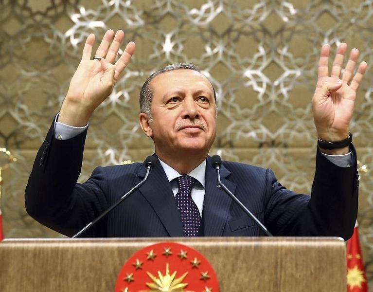 Turkey's President Recep Tayyip Erdogan speaks during a meeting with local media representatives, in Ankara, Turkey, Wednesday, March 22, 2017. Tensions between Turkey and Europe have boiled in recent weeks, but acrimony over Turkey's belief that some European countries are harboring suspected terrorists has festered for years. Erdogan criticized Germany Wednesday for allowing a weekend rally of Kurds, some of whom expressed support for a jailed rebel leader in Turkey.(Kayhan Ozer/Presidential Press Service, Pool Photo via AP)