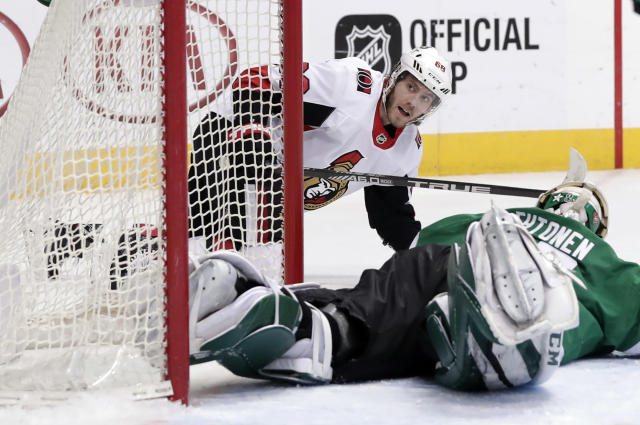 Ottawa Senators left wing Mike Hoffman (68) gets up off the ice after scoring against Dallas Stars goalie Kari Lehtonen (32) of Finland in the second period of an NHL hockey game in Dallas, Monday, March 5, 2018. (AP Photo/Tony Gutierrez)