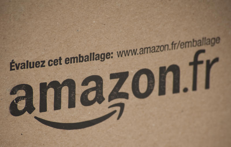 Alston, UK - March 25, 2011: A cardboard packaging box with the printed logo of Amazon.fr, the online retail company.