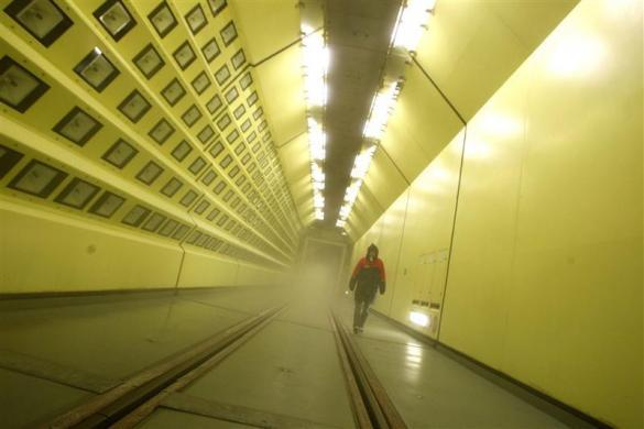 An employee walks inside the world's largest climatic wind tunnel for rail vehicles at Rail Tec Arsenal in Vienna April 27, 2012. The company investigates the impact of weather on vehicles and components under realistic operating conditions, according to its website.