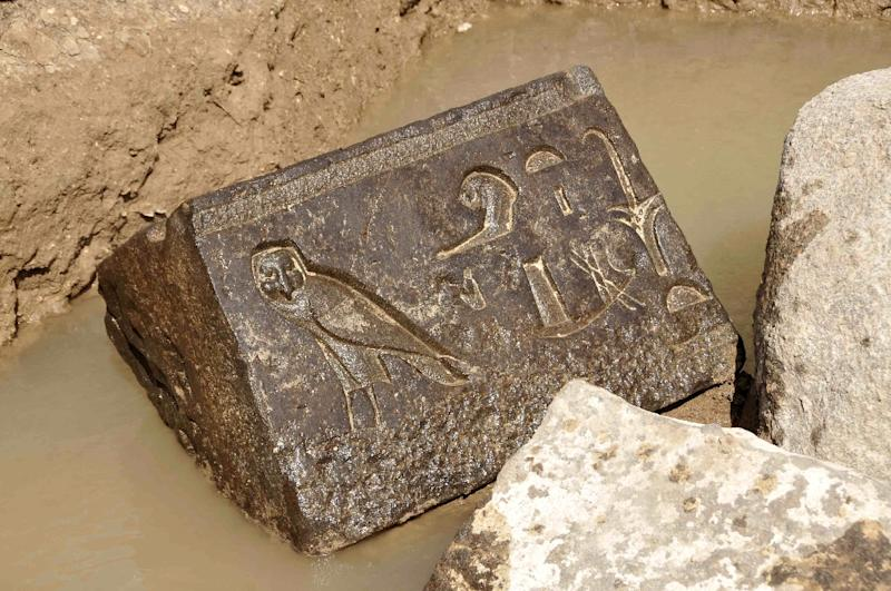 A picture released by Egypt's Supreme Council of Antiquities on April 14, 2015 shows a carved basalt block, a piece that belongs to the bottom part of a chapel belonging to King Nectanebo I