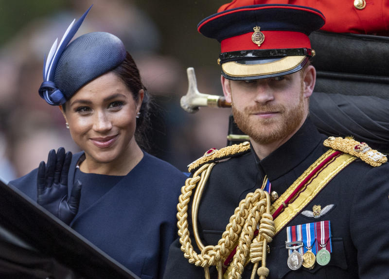 Prince Harry and Meghan Markle wave at crowds at Trooping of the Colour 2019