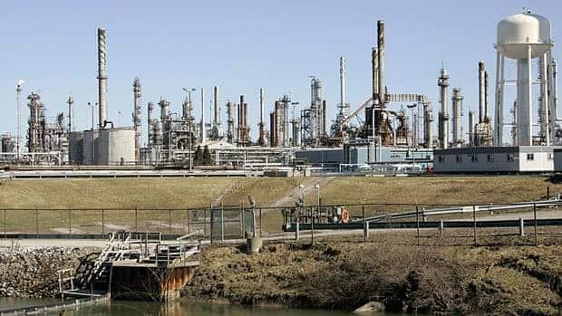 Oil from Western Canada makes it as far east as Sarnia, Ont., home to refineries like this one. Enbridge is proposing to reverse the flow of oil from the pipeline that connects Sarnia to Hamilton. (Dave Chidley/Canadian Press - image credit)