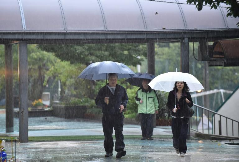 Rain lashed most of Japan on election day as Typhoon Lam approaches the country
