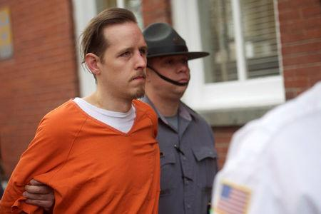 Eric Matthew Frein exits the Pike County Courthouse with police officers after an arraignment in Milford