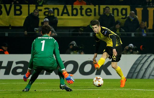 Soccer Football - Europa League Round of 32 First Leg - Borussia Dortmund vs Atalanta - Signal Iduna Park, Dortmund, Germany - February 15, 2018 Borussia Dortmund's Christian Pulisic in action with Atalanta's Etrit Berisha REUTERS/Leon Kuegeler