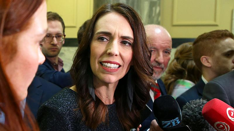 Pictured here, New Zealand PM Jacinda Ardern addresses members of the media.