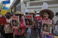 Anti-coup protesters display placards near Indonesian Embassy in Yangon, Myanmar Wednesday, Feb. 24, 2021. Anti-coup protesters gathered outside the Indonesian Embassy following reports that Indonesia was seeking to have fellow members of the Association of Southeast Asian Nations to agree on an action over the Myanmar's coup that would hold the junta to its promise to hold free and fair elections in a year's time. The Indonesia Foreign Ministry has denied the report. (AP Photo)