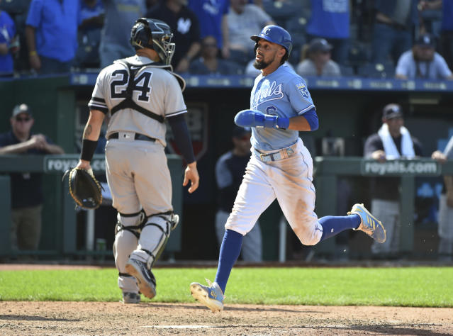 Kansas City Royals' Billy Hamilton crosses home past New York Yankees catcher Gary Sanchez to score the game-winning run on a Whit Merrifield single in the 10th inning during a baseball game Sunday, May 26, 2019, in Kansas City, Mo. The Royals won 8-7. (AP Photo/Ed Zurga)