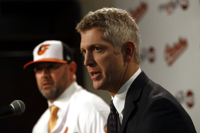 Baltimore Orioles executive vice president and general manager Mike Elias speaks at an introductory news conference for manager Brandon Hyde, back left, Monday, Dec. 17, 2018, in Baltimore. Hyde is the 20th manager in the team's history. (AP Photo/Patrick Semansky)