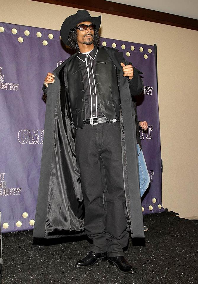 "Welcome to the Wild Wild Westside! Snoop rocked this ghastly getup at the CMT Music Awards, where he should have won a trophy for ""Worst Performance by a Ridiculously-dressed Rapper."" <a href=""http://www.wireimage.com"" target=""new"">WireImage.com</a> - April 14, 2008"