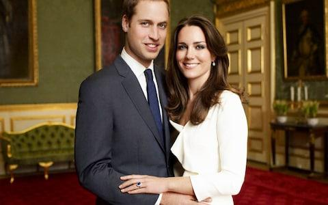 Prince William and Kate Middleton pose in their official engagement photo in 2010 - Credit: Mario Testino