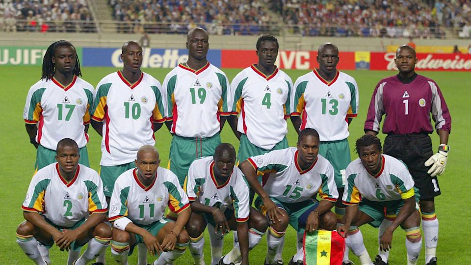 The Senegalese national soccer team at WC in 2002. | PORNCHAI KITTIWONGSAKUL/Getty Images