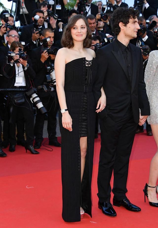 <p>Marion Cotillard took the lace-up trend to classier level with a black gown from Jean Paul Gaultier. (Photo: Getty Images) </p>