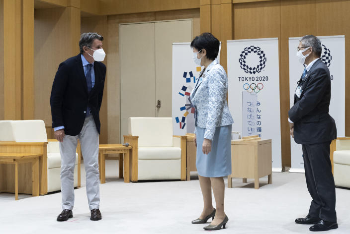 Sebastian Coe, left, the president of World Athletics, an internationally governing organization for the sport of athletics, greets Tokyo Gov. Yuriko Koike before they have a talk in Tokyo on Friday, May 7, 2021. Seiko Hashimoto, the president of the Tokyo Olympic organizing committee, said Friday IOC President Thomas Bach to make a planned visit this month to Japan with a state of emergency order being extended by the government until May 31 to Tokyo and other areas. (AP Photo/Hiro Komae)