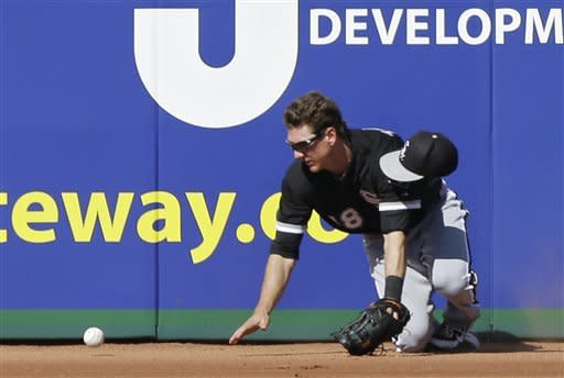Chicago White Sox center fielder Blake Tekotte crashes into the wall while chasing a double by Cleveland Indians' Mark Reynolds in the fifth inning of an exhibition spring training baseball game on Friday, March 1, 2013, in Goodyear, Ariz. (AP Photo/Mark Duncan)