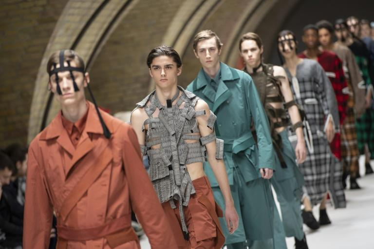Gender-fluid: Models walk the catwalk in the finale to Craig Green's London fashion show last January