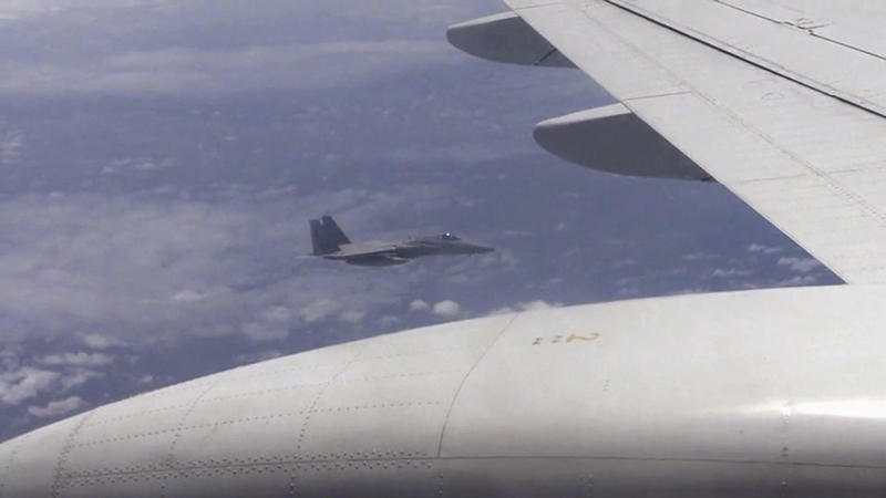 Still image from video footage of Japanese F-15 jet and Chinese Tu-154 jet over the East China Sea