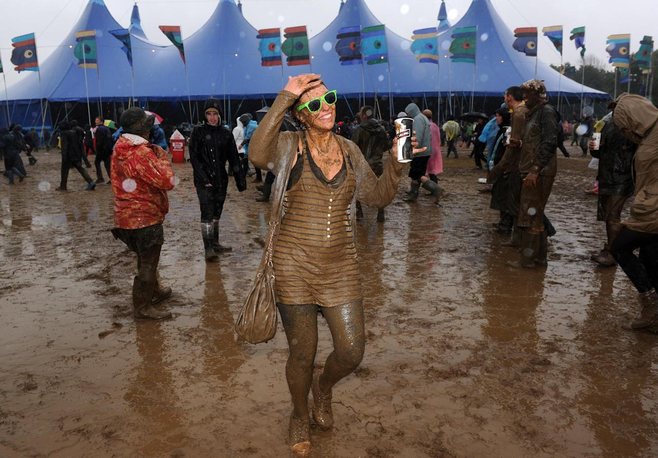 A girl is seen soaked in mud at the Isle of Wight Festival after torrential downpours last weekend.