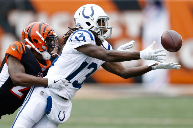<p>Indianapolis Colts wide receiver T.Y. Hilton (13) misses a pass with Cincinnati Bengals cornerback Darqueze Dennard, left, in pursuit in the first half of an NFL football game, Sunday, Oct. 29, 2017, in Cincinnati. (AP Photo/Gary Landers) </p>
