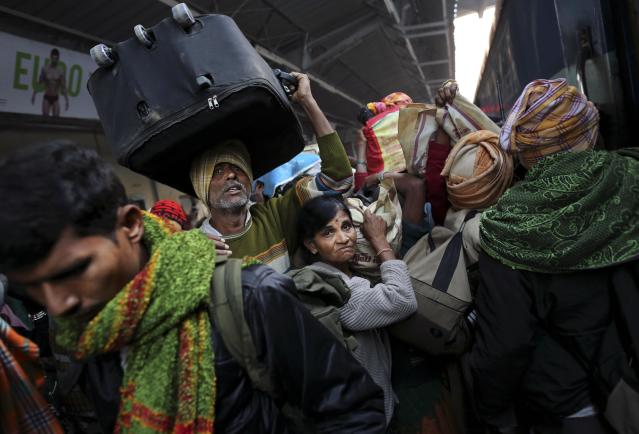 Indians crowd on a train on platform six near where a stampede took pace a night before, at a station in Allahabad, India, Monday, Feb. 11, 2013. The death toll from a stampede in a train station rose to 36 on Monday in the northern India city where millions of devotees had gathered for a Hindu festival that is one of the world's largest religious gatherings. (AP Photo/Kevin Frayer)
