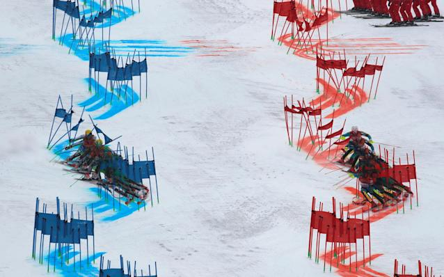 """Alpine Skiing - Pyeongchang 2018 Winter Olympics - Team Event - Yongpyong Alpine Centre - Pyeongchang, South Korea - February 24, 2018 - Stefan Hadalin of Slovenia (L) and Mattias Hargin of Sweden compete. Picture taken with multiple exposure. REUTERS/Stefano Rellandini SEARCH """"OLYMPICS BEST"""" FOR ALL PICTURES. TPX IMAGES OF THE DAY."""