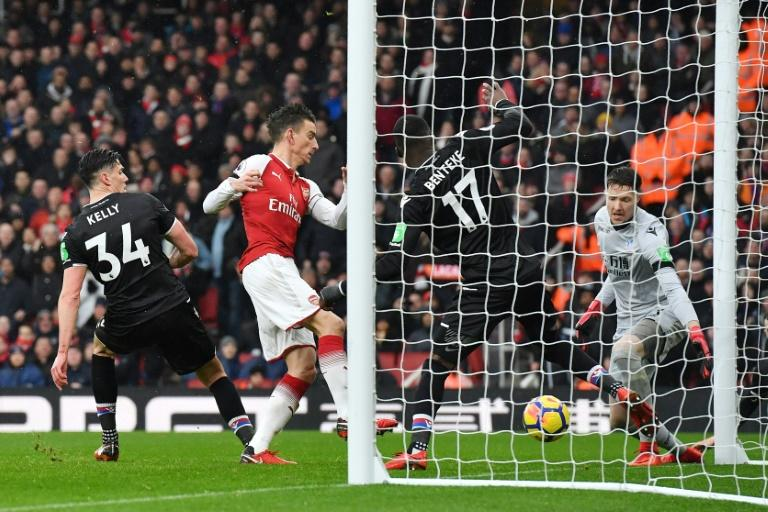 Arsenal's defender Laurent Koscielny (2L) shoots and scores their third goal during the English Premier League football match against Crystal Palace January 20, 2018