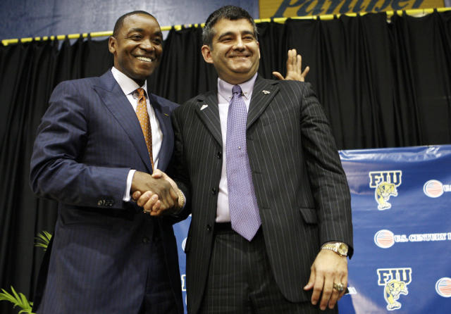 Isiah Thomas, left, shakes hands with Florida International athletic director Pete Garcia, right, following a news conference that introduced Thomas as the new men's college basketball coach at FIU, Wednesday, April 15, 2009, in Miami. (AP Photo/Lynne Sladky)