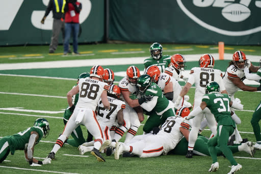 Cleveland Browns running back Kareem Hunt (27) recovers a fumble by quarterback Baker Mayfield during the second half of an NFL football game against the New York Jets, Sunday, Dec. 27, 2020, in East Rutherford, N.J. The ruling on the field resulted in a turnover on downs ending the drive. (AP Photo/Corey Sipkin)