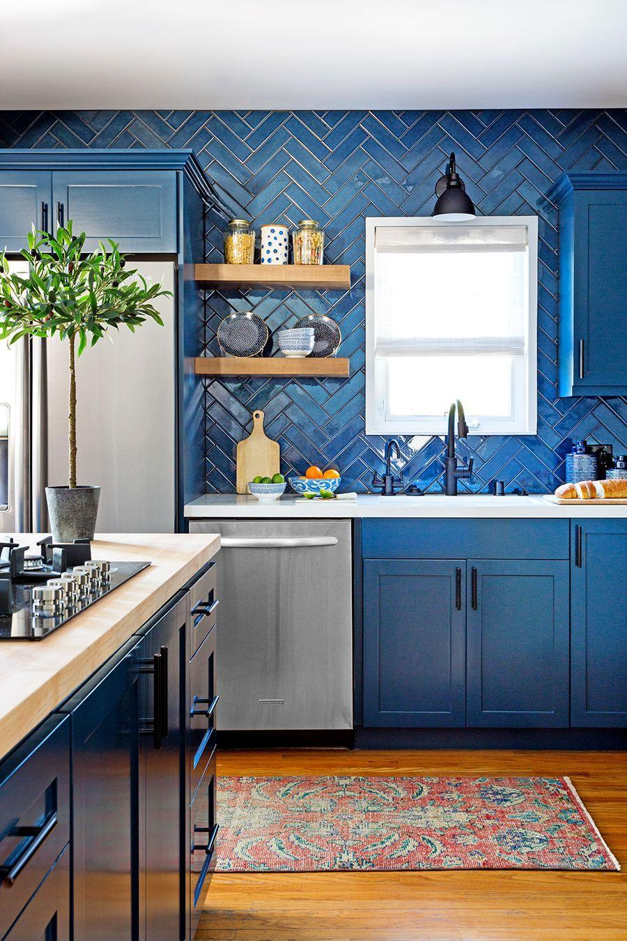 "<p>For this Los Angeles kitchen, <a href=""https://www.jennfeldmandesigns.com/"" rel=""nofollow noopener"" target=""_blank"" data-ylk=""slk:Jenn Feldman Designs"" class=""link rapid-noclick-resp"">Jenn Feldman Designs</a> chose a tonal grout to blend in with the navy tile, which is set in a refreshingly unexpected chevron pattern. It feels unexpected and interesting but fits in well since it matches the lower cabinets.</p>"