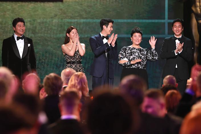 """Parasite"" cast members Song Kang-ho, Cho Yeo-jeong, Choi Woo-shik, Lee Jung-eun, Chang Hyae-jin and Lee Sun-kyung present a clip of ""Parasite"" onstage during the 26th Annual Screen Actors Guild Awards. (Photo: Rich Fury via Getty Images)"