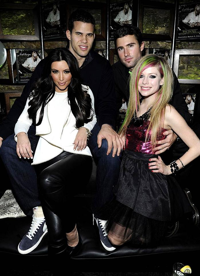 "It's pretty funny to think that Kim and Avril could one day be sisters-in-law as Avril is dating Kim's stepbrother, Brody Jenner! The trio posed for a cute family picture with Kim's new beau, NBA player Kris Humphries, at the Onitsuka Tiger and RCA Records-sponsored event. Kevin Mazur/<a href=""http://www.wireimage.com"" target=""new"">WireImage.com</a> - March 8, 2011"
