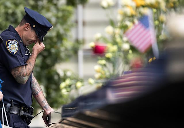 <p>A New York City Police Department (NYPD) officer breaks down while visiting the North pool during a commemoration ceremony for the victims of the September 11 terrorist attacks at the National September 11 Memorial, September 11, 2017 in New York City. (Photo: Drew Angerer/Getty Images) </p>