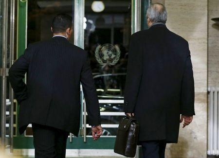 Syrian Ambassador to the U.N. Bashar al Jaafari (R) leaves after the first day of the Syrian peace talks at the United Nations European headquarters in Geneva, Switzerland, January 29, 2016. REUTERS/Denis Balibouse