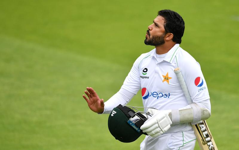 Pakistan's Azhar Ali leaves the field after losing his wicket during the first day of the first Test cricket match between England and Pakistan at Old Trafford in Manchester, northwest England on August 5, 2020. - DAN MULLAN/POOL/AFPvia Getty Images