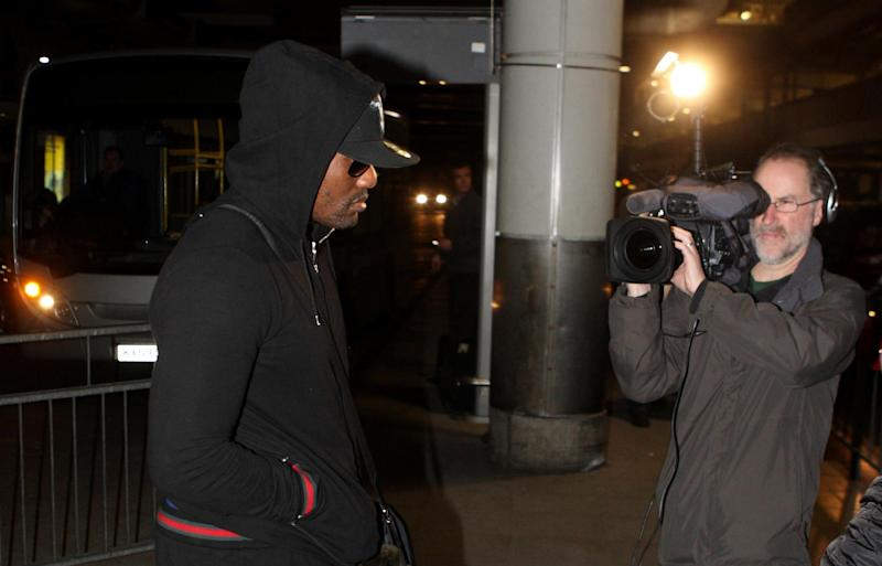 British boxer Dereck Chisora, left, arrives back at Heathrow Airport in London Sunday, Feb. 19, 2012 following his WBC heavyweight title fight with Vitali Klitschko in Munich, Germany, Saturday night. Chisora was released Sunday after nearly seven hours of questioning by police following his brawl with former WBA champion David Haye at a post-fight news conference. (AP Photo/PA, Steve Parsons) UNITED KINGDOM OUT: NO SALES: NO ARCHIVE