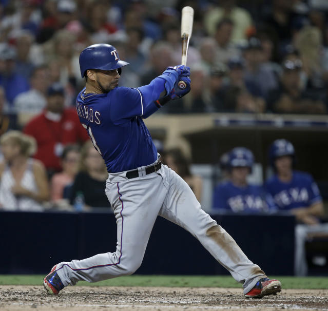 Texas Rangers' Robinson Chirinos hits a three-run double against the San Diego Padres during the sixth inning of a baseball game in San Diego, Saturday, Sept. 15, 2018. (AP Photo/Alex Gallardo)