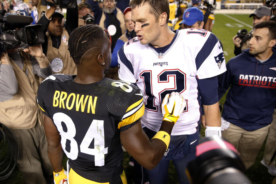 New England Patriots quarterback Tom Brady (12) talks with Pittsburgh Steelers wide receiver Antonio Brown (84) on the field after an NFL football game in Pittsburgh, Sunday, Oct. 23, 2016. (AP Photo/Jared Wickerham)