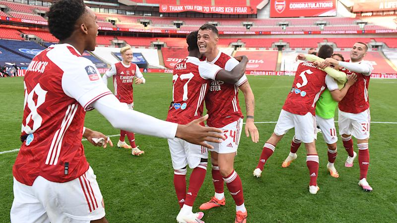 Arsenal players, pictured here celebrating after winning the FA Cup.