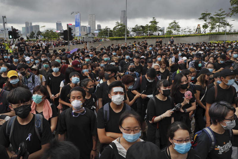 Protesters wearing masks gather near the Legislative Council as they continuing protest against the unpopular extradition bill in Hong Kong, Monday, June 17, 2019. A member of Hong Kong's Executive Council says the city's leader plans to apologize again over her handling of a highly unpopular extradition bill. (AP Photo/Kin Cheung)