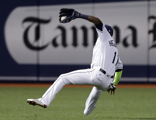Tampa Bay Rays shortstop Adeiny Hechavarria makes an off balance catch on a pop out by Boston Red Sox's Eduardo Nunez during the third inning of a baseball game Friday, March 30, 2018, in St. Petersburg, Fla. (AP Photo/Chris O'Meara)