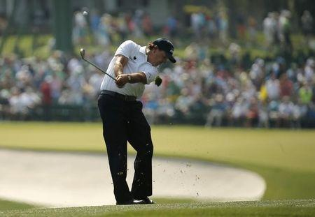 Phil Mickelson of the U.S. hits on the first fairway during first round play of the Masters golf tournament at the Augusta National Golf Course in Augusta, Georgia April 9, 2015. REUTERS/Brian Snyder