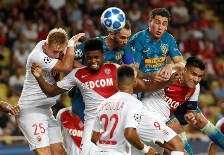 Soccer Football - Champions League - Group Stage - Group A - AS Monaco v Atletico Madrid - Stade Louis II, Monaco - September 18, 2018  Atletico Madrid's Diego Godin and Jose Gimenez in action with AS Monaco's Kamil Glik, Radamel Falcao and team mates  REUTERS/Eric Gaillard