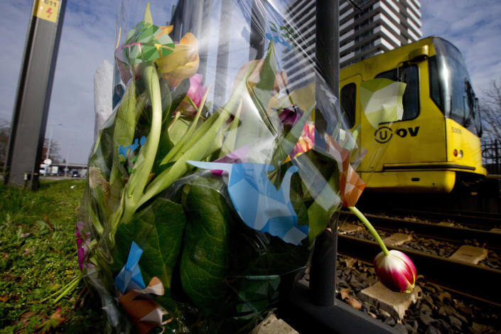 A tram passes flowers placed at the site of a shooting incident on a tram, in Utrecht, Netherlands, March 19, 2019. (Photo: Peter Dejong/AP)