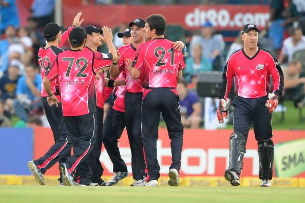 PRETORIA, SOUTH AFRICA - OCTOBER 26: (SOUTH AFRICA OUT) The Sydney Sixers team celebrate the wicket of Jacques Rudolph during the Karbonn Smart CLT20 Semi Final match between Nashua Titans and Sydney Sixers at SuperSport Park on October 26, 2012 in Pretoria, South Africa (Photo by Duif du Toit/Gallo Images/Getty Images)